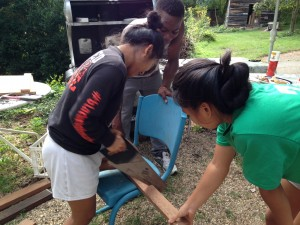 July and Htoogaye showing Abass how to saw the wood! Girl power!